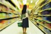 Woman in aisle at supermarket