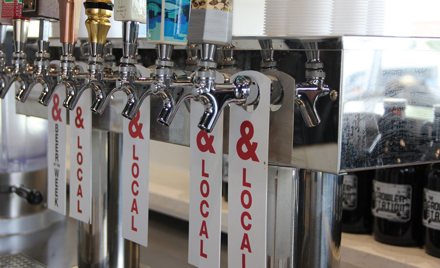 A Kum & Go in Iowa features local beers as part of its growler taps.